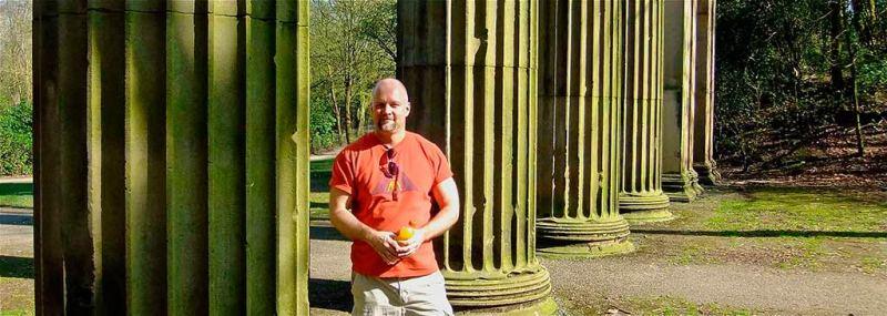 mark leaning on stone pillars heaton park
