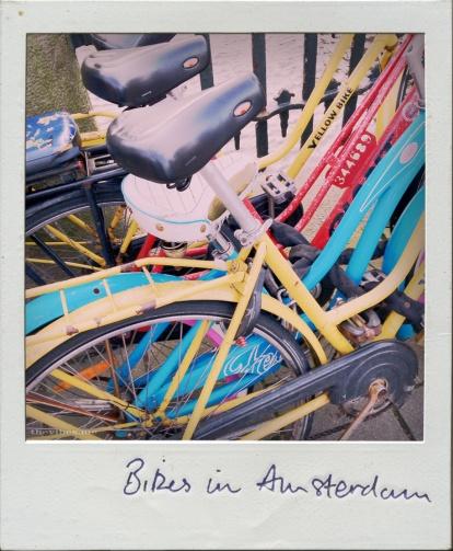 Coloured bikes amsterdam polaroid the vibes