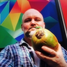 Mark Wallis drinking coconut milk in London on thevibes.me